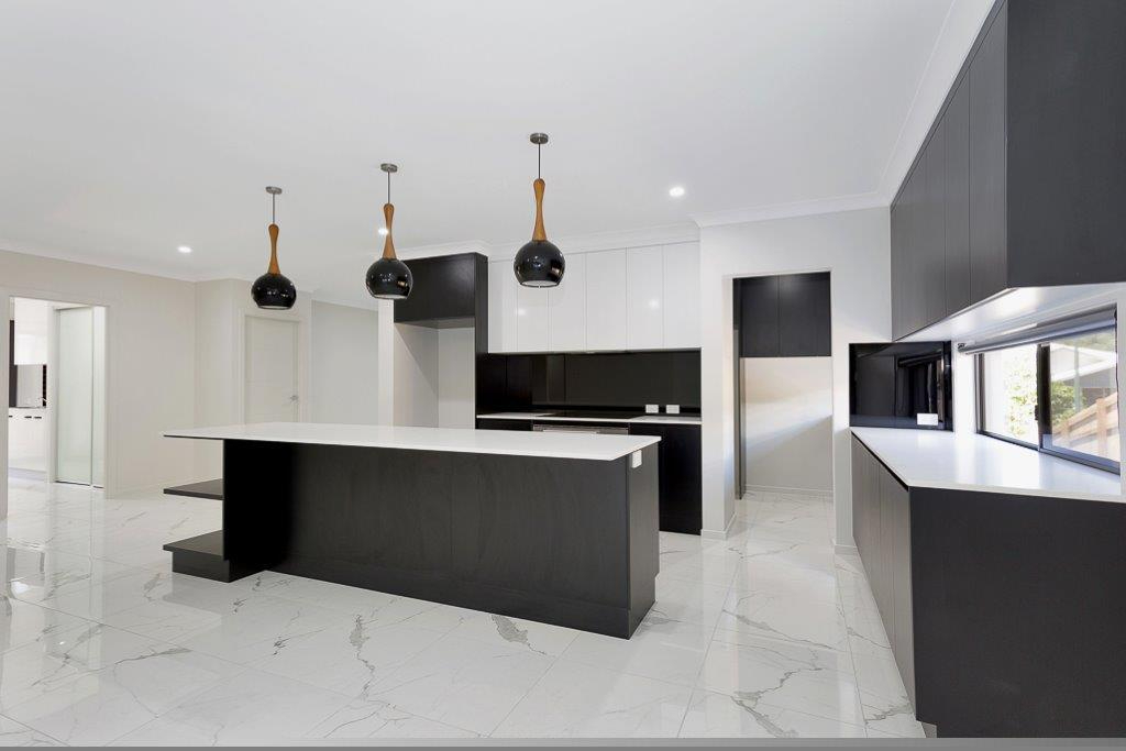 Black And White Table In Kitchen — Kitchen design in Paget, QLD