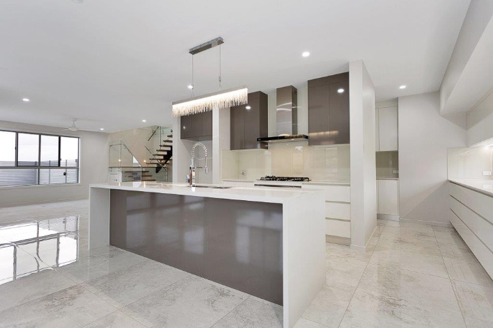 Brown And White Table In Kitchen — Kitchen design in Paget, QLD